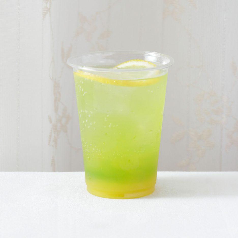 京都会場-12 kyoto   焼酎甲類をグラス1/3程度注ぐ 氷を2~3個入れる マンゴージュースを1/3程度注ぐ バナナリキュール:15ml トニックウォーターで満す レモンを浮かべて出来上がり    焼酎:NIPPON マンゴージュース バナナリキュール トニックウォーター レモン